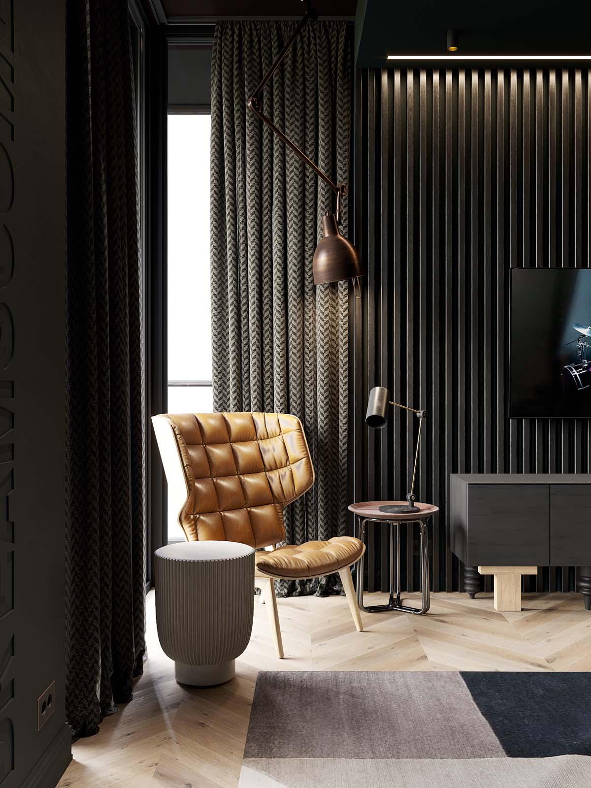 2个大胆暗黑色装饰的小户型公寓