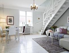 拥有漂亮楼梯的黑白色复式公寓室内设计