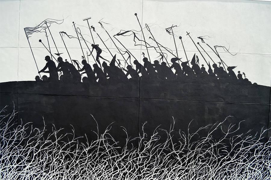 黑色剪影打造的街头艺术作品