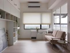 拥有家庭办公室的白色公寓设计